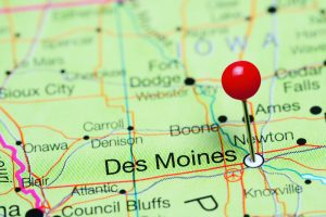 Des Moines pinned on a map of Iowa, USA
